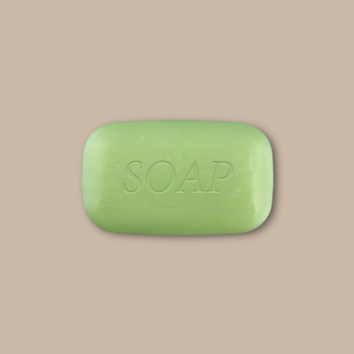 green soap bar against brown background