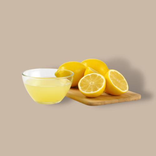 lemons and lemon juice against brown background