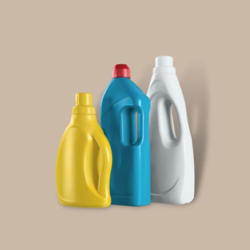3 laundry detergent bottles against brown background