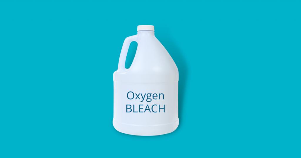 a bottle of oxygen bleach against blue background
