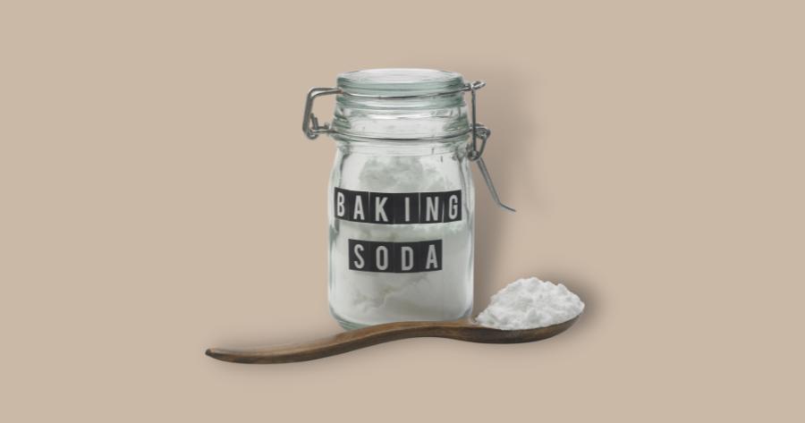 baking soda in a mason jar and a spoonful of baking soda