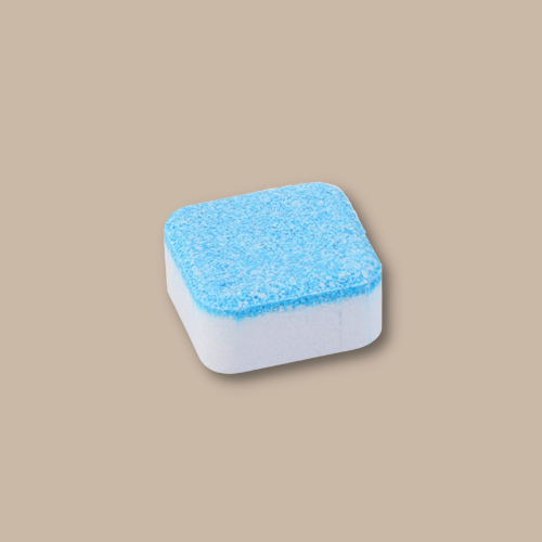 color white rectangular cleaning tablet that has blue shade on top