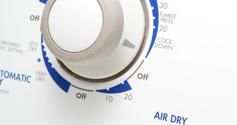 close up of the dial of a clothes dryer